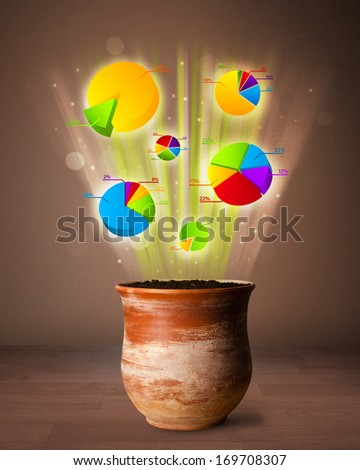 Glowing pie charts coming out from flowerpot - stock photo