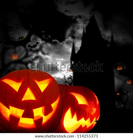 Glowing pumpkins in a dark scary forest with cemetery - stock photo