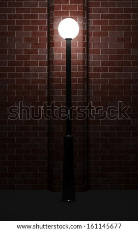 Glowing Street Lamp at Night near the Brick Wall - stock photo