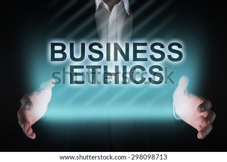 "Glowing text ""Business ethics"" in the hands of a businessman. Business concept. Internet concept. - stock photo"