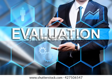 "Glowing text ""Evaluation"" in the hands of a businessman. Business concept. Internet concept. - stock photo"
