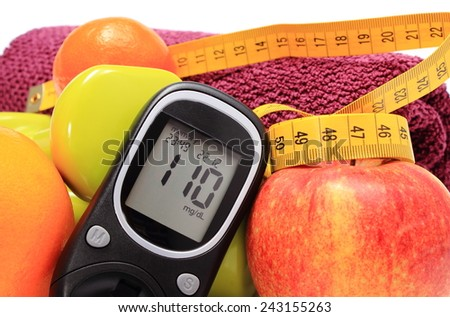 Glucose meter, fresh fruits, tape measure, dumbbells and purple towel for using in fitness, concept for diabetes, slimming, lifestyle and healthy nutrition - stock photo