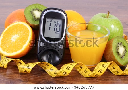 Glucose meter, fresh ripe fruits, glass of juice and tape measure, grapefruit orange kiwi apple, concept of diabetes, healthy lifestyles and strengthening immunity - stock photo