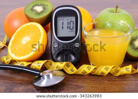 Glucose meter, medical stethoscope, fresh ripe fruits, glass of juice and tape measure, grapefruit orange kiwi apple, concept of diabetes and healthy lifestyles - stock photo