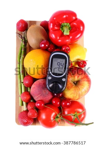 Glucose meter with fresh ripe fruits and vegetables, concept of diabetes, healthy food, nutrition and strengthening immunity. White background - stock photo