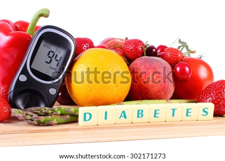 Glucose meter with fresh ripe fruits and vegetables on wooden cutting board, concept of diabetes, healthy food, nutrition and strengthening immunity - stock photo