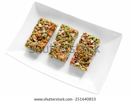 Gluten free almond apricot granola bars on white plate isolated on white background - stock photo
