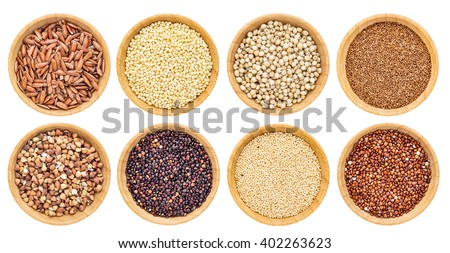 gluten free grains collection  - buckwheat, amaranth, brown rice, millet, sorghum, teff, black and red quinoa - top view of isolated wooden bowls - stock photo