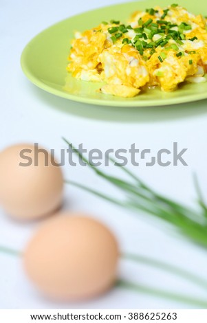 gluten-free meal- scrambled eggs with chives - stock photo