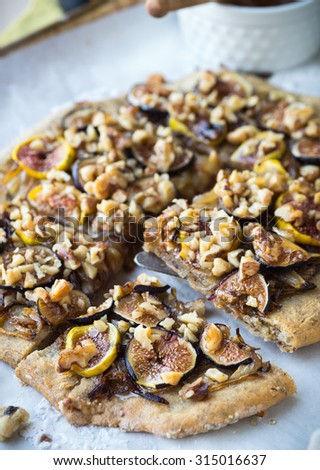 Gluten free pizza with fresh figs and onions - stock photo