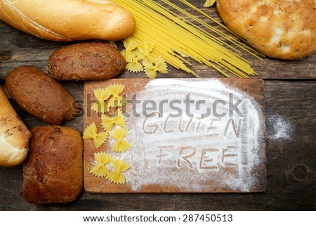 gluten free  word with bread on wood background - stock photo