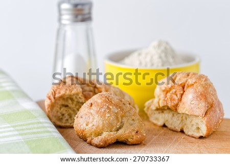 Gluten's buns and oat bran (front view) - on the background: salt and flour - stock photo
