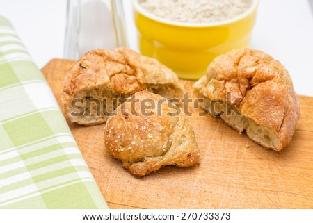 Gluten's buns and oat bran top view - on the background: salt and flour - stock photo