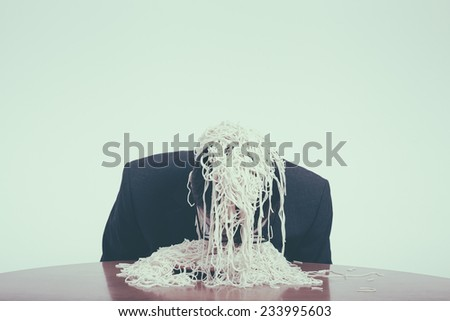 Gluttony and consumerism concept. Greedy businessman eating pasta. - stock photo