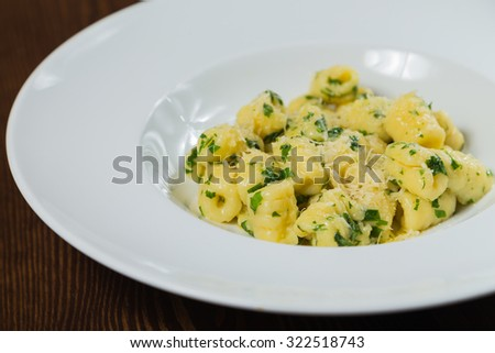 Gnocchi on a plate. Tasty and healthy food - stock photo