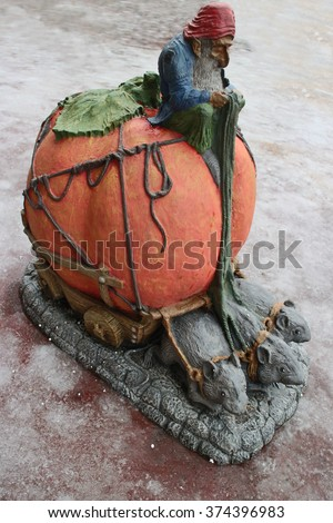 Gnome on a pumpkin ruler of mouse carriage  - stock photo