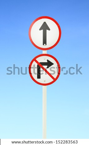 go ahead the way ,forward sign and don't turn right sign with blue sky - stock photo