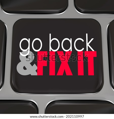 Go Back Fix It black computer keyboard key program software or application correct mistakes - stock photo