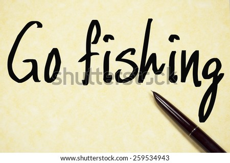 go fishing text write on paper  - stock photo