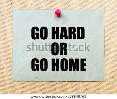 Go Hard Or Go Home written on paper note pinned with red thumbtack on wooden board. Business conceptual Image - stock photo