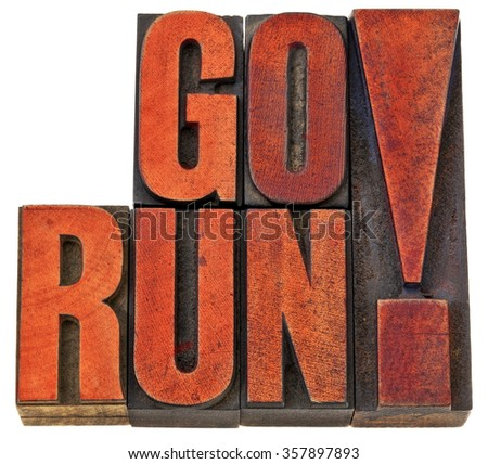go run motivation banner - fitness concept - isolated word abstract in letterpress wood type stained by red ink - stock photo