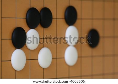 go stones on board - stock photo