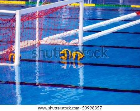 Goal and balls in the pool before the waterpolo game. - stock photo