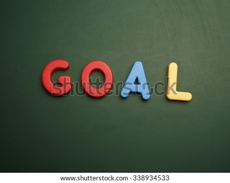 goal concept in colorful letters isolated on blank blackboard - stock photo