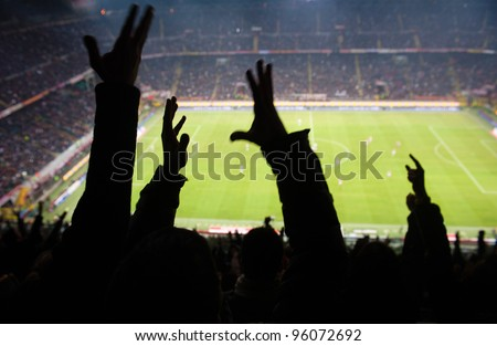 Goal! Crowd of footbal supporters and fans cheer at the studium.  - stock photo