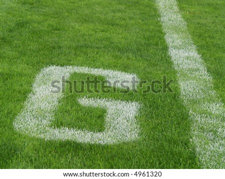 goal line - G - on an American football field - stock photo