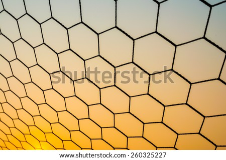 Goal net in the sunset - stock photo