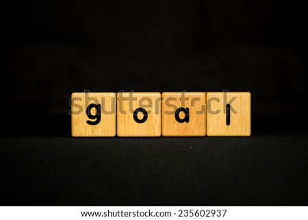 goal wood Cubic on black background - stock photo