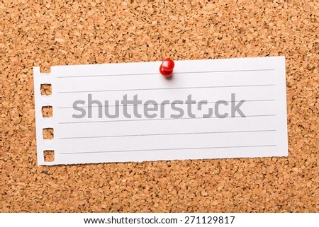 Goal. Write Down Your Goals typed on a scrap of paper pinned to a cork notice board. Writing down goals helps to make them more real and will provide focus as you plan the steps to reach them. - stock photo