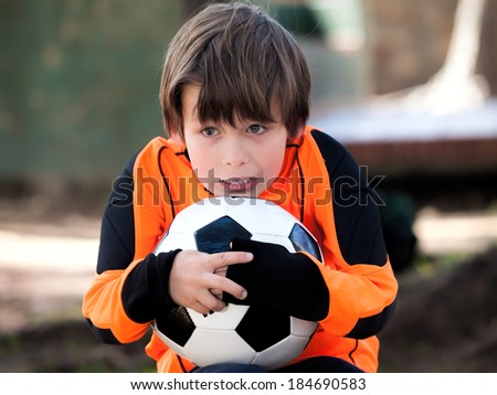 Goalkeeper Boy with football soccer / shirt and ball in a park - stock photo