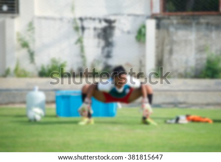 Goalkeeper in action playing football, Stretching (soccer) - stock photo