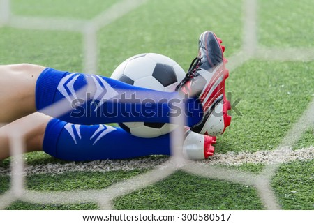 Goalkeeper protection soccer ball into the goal - stock photo