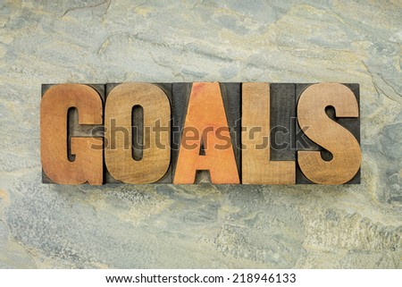 goals  - a word in vintage letterpress wood type on a green slate rock background - stock photo