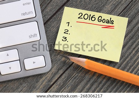 goals for 2016 written on a note, with desk background - stock photo