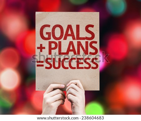 Goals + Plans = Success card with colorful background with defocused lights - stock photo