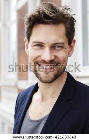 Goatee guy smiling at camera - stock photo