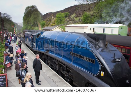 GOATHLAND, ENGLAND - MAY 20: Sir Nigel Gresley Class A4 4498 locomotive, one of only six remaining on May 20, 2013 in Goathland, England - stock photo