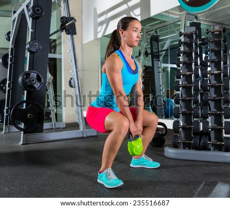 goblet kettlebell squat woman workout exercise at gym - stock photo