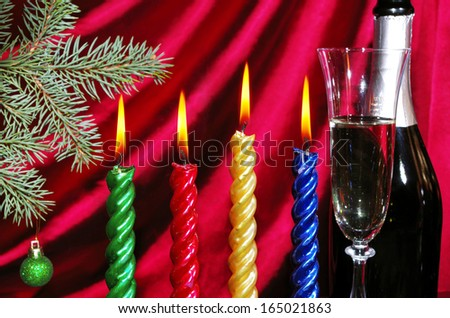 Goblet of champagne and new year decoration against purple drapery - stock photo