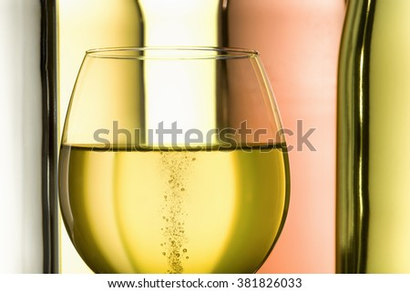 goblet with sparkling white wine and bottles on background - stock photo