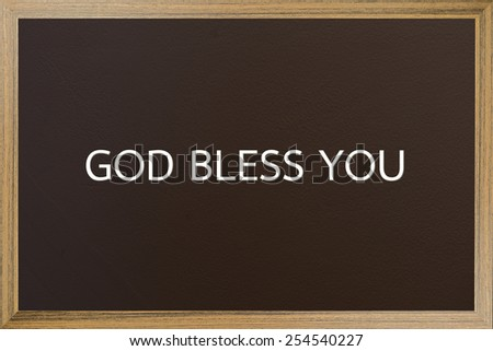 God bless you on brown blackboard - stock photo