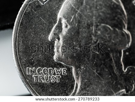 God. In God we trust. Beat up quarter - stock photo