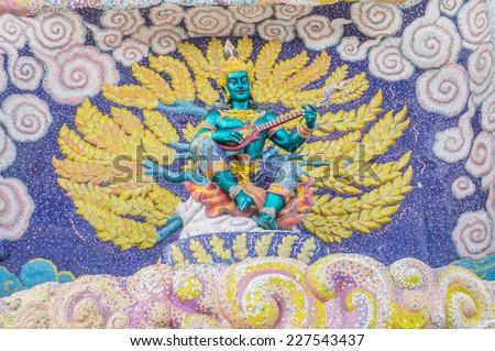 God of mythology sculpture on entrance of the sanctuary in Ban Rai temple, Korat, Thailand - stock photo