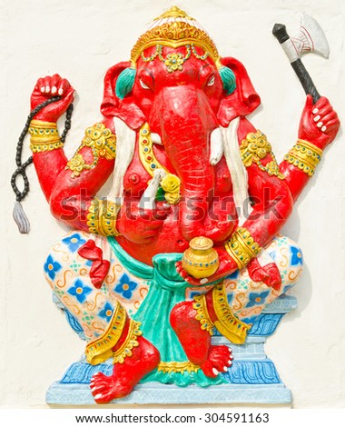 God of success 27 of 32 posture. Indian style or Hindu God Ganesha avatar image in stucco low relief technique with vivid color,Wat Samarn, Chachoengsao,Thailand. - stock photo
