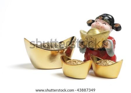 God of Wealth Figurine with Gold Ingots on White Background - stock photo