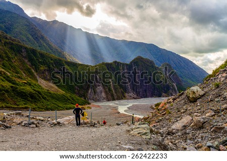God rays in Fox glacier valley in South Alps, South island of New Zealand - stock photo